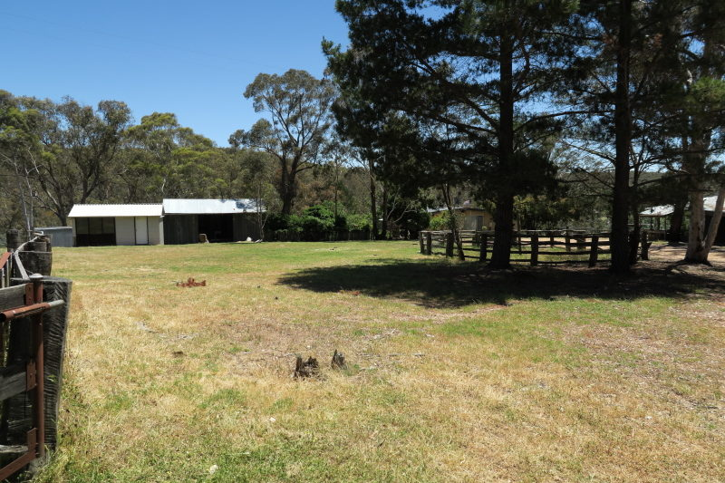 2 - up by the other set of stables, looking west, down the longest part of the flat 'paddock' near to the parking and outdoor entertainment area